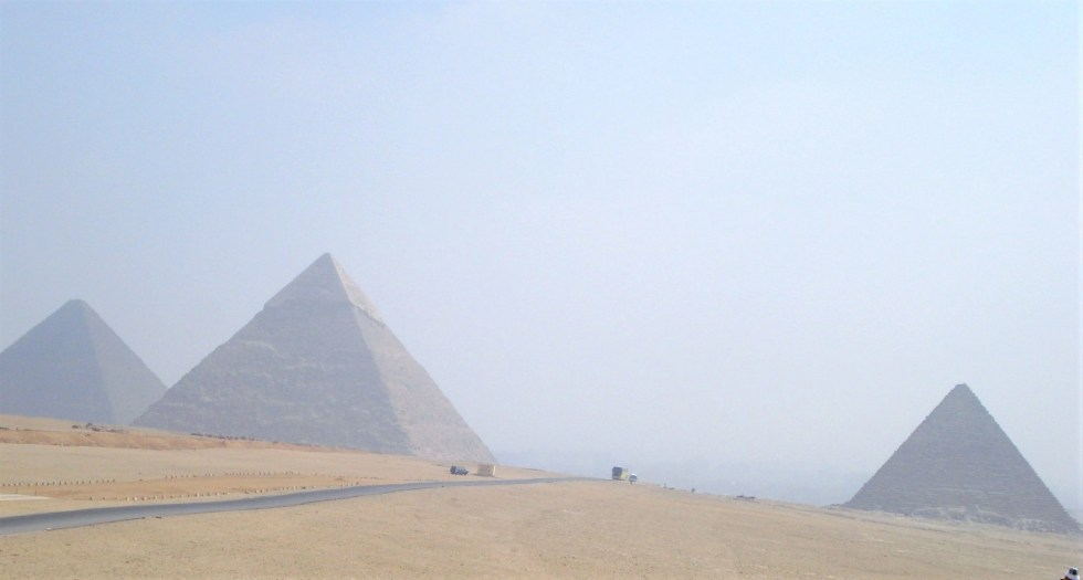 The three pyramids of Egypt at Giza from a distance