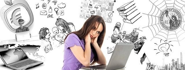 Woman Focusing On Laptop With Distractions All Around Her