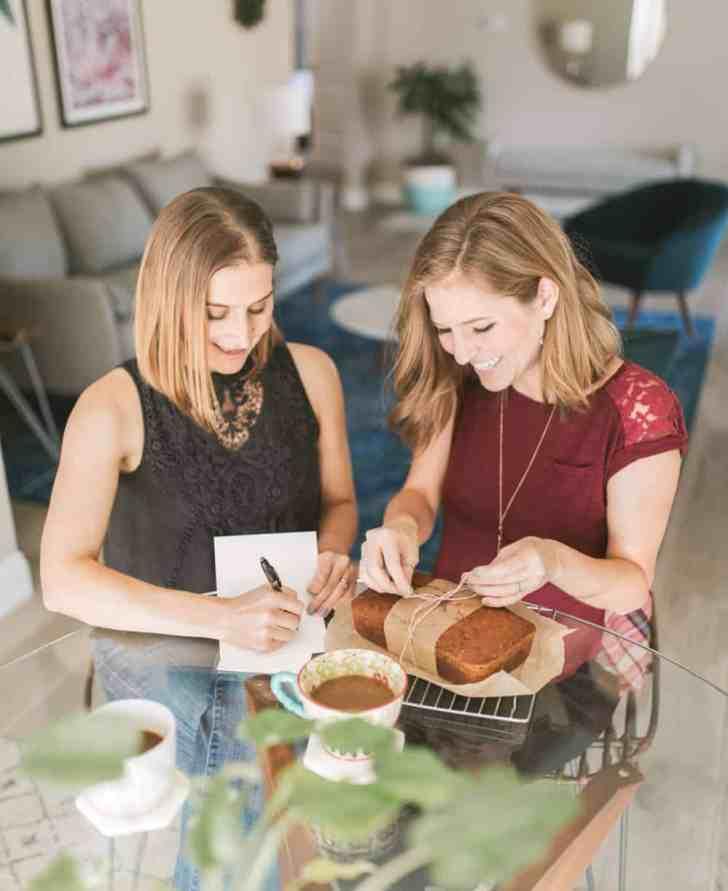 Vegan Gift Ideas | Michelle Cehn & Kristie Middleton Wrapping Homemade Pumpkin Bread & Writing Holiday Cards | WorldofVegan.com | #diy #vegan #holiday #gifts