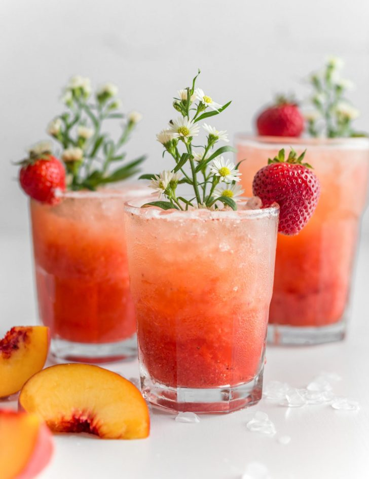 Bubbly Strawberry Peach Sprirtzer In a Glass Garnished with a Fresh Strawberry