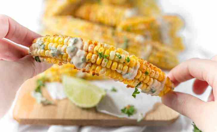 Chipotle Air Fryer Corn Ribs Held Up Close