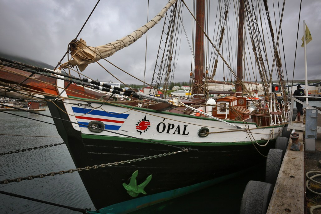 The Opal, a 33 meter schooner and once fishing vessel, now converted to carbon neutral —electric for quiet whale watching by North Sailing in Husavik, Iceland
