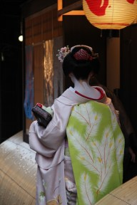 A maiko on her way to the evening engagement
