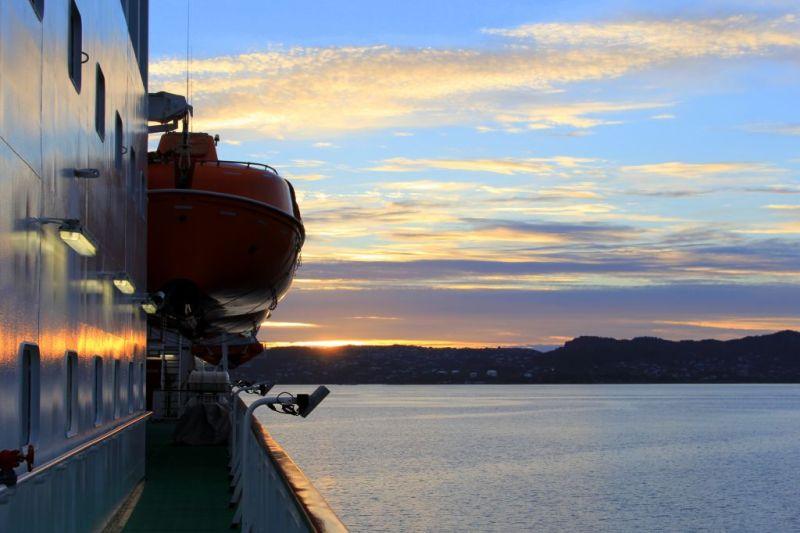 Leaving Bergen at sunset, Norway coastal voyage