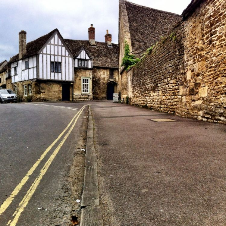 Wooden curbs in Lacock, Wiltshire England