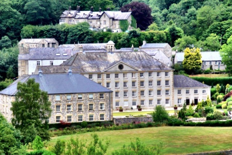 Cressbrook Mill viewed from the Monsal Trail in Derbyshire England