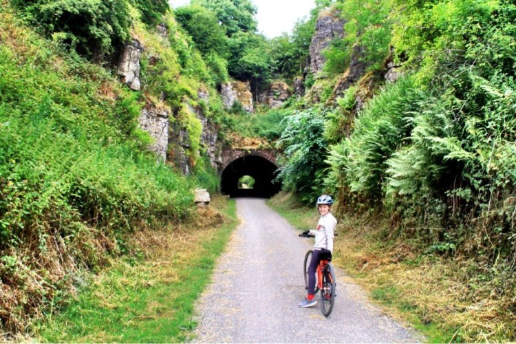 Family bike ride on the Monsal Trail Derbyshire Peak District UK