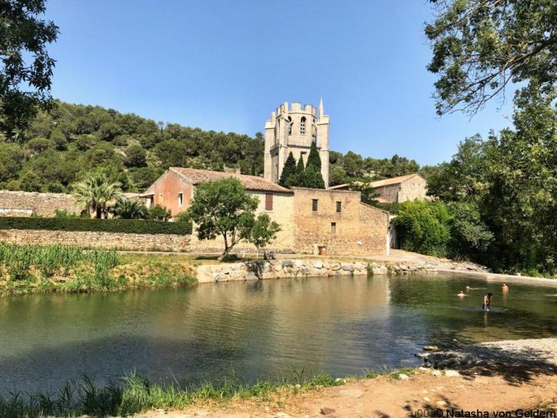 Abbey of St. Mary of Lagrasse and the River Orbieu