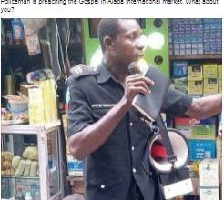 Photo of Policeman Pictured Preaching At Alaba International market (Photos/Video)