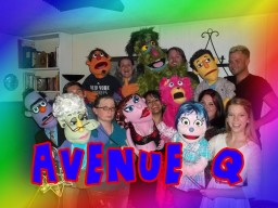 The cast of Avenue Q and their puppets