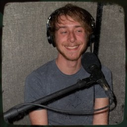 Clinton Philbin, drummer for Failure Machine, smiling and looking to the side