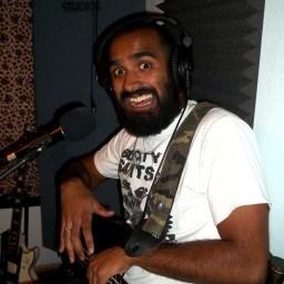 Rash Kader smiling as if in pain