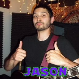 Jason, not smiling, giving a double thumbs-up
