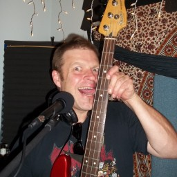 Kris Praster licking his bass neck