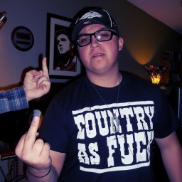 """Elijah Frandsen's hand flipping off Cody Sprague who is flipping off the camera in a """"Country as fuck"""" t-shirt"""
