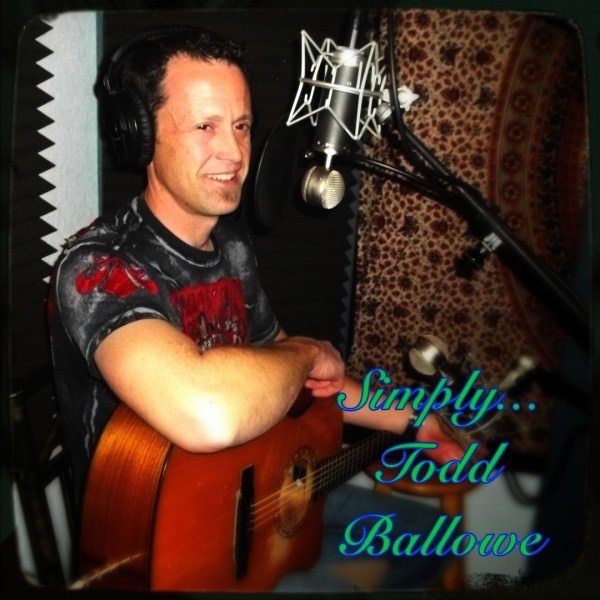 """Todd Ballowe, sitting with guitar, with the text """"Simply... todd ballowe"""" in a fancy script"""