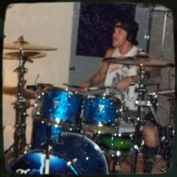 Brooklyn Reiff at his drumkit in the distance