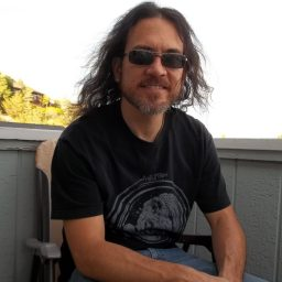 Dennis Donaghy, the solo artists behind Phaedrx, relaxing and smiling on the porch at Dogwater Studios