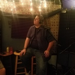 Reno comedian Pat Shollito stares off into space while recording the Worst Little Podcast.