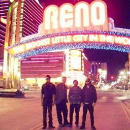 All members of Reno surf punk band Riptide Bandits posing under the Reno arch.