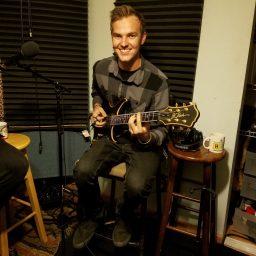 Dawson Copeland of Reno metal-core band Salythian posing with his guitar.