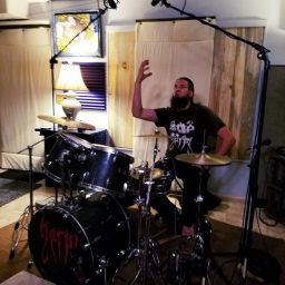 Drummer for Reno metal band Qarin posing for the camera at Dogwater Studios.