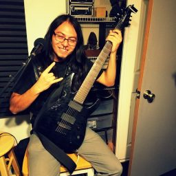 Sancho of Reno metal band Qarin posing for the camera at Dogwater Studios.