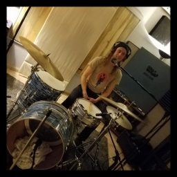 Clinton from Reno band Failure Machine playing drums at Dogwater Studios.