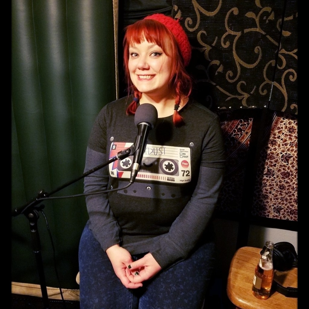 Reno comedian, Aubrey Forston, smiling for the camera while recording for the Worst Little Podcast at Dogwater Studios.