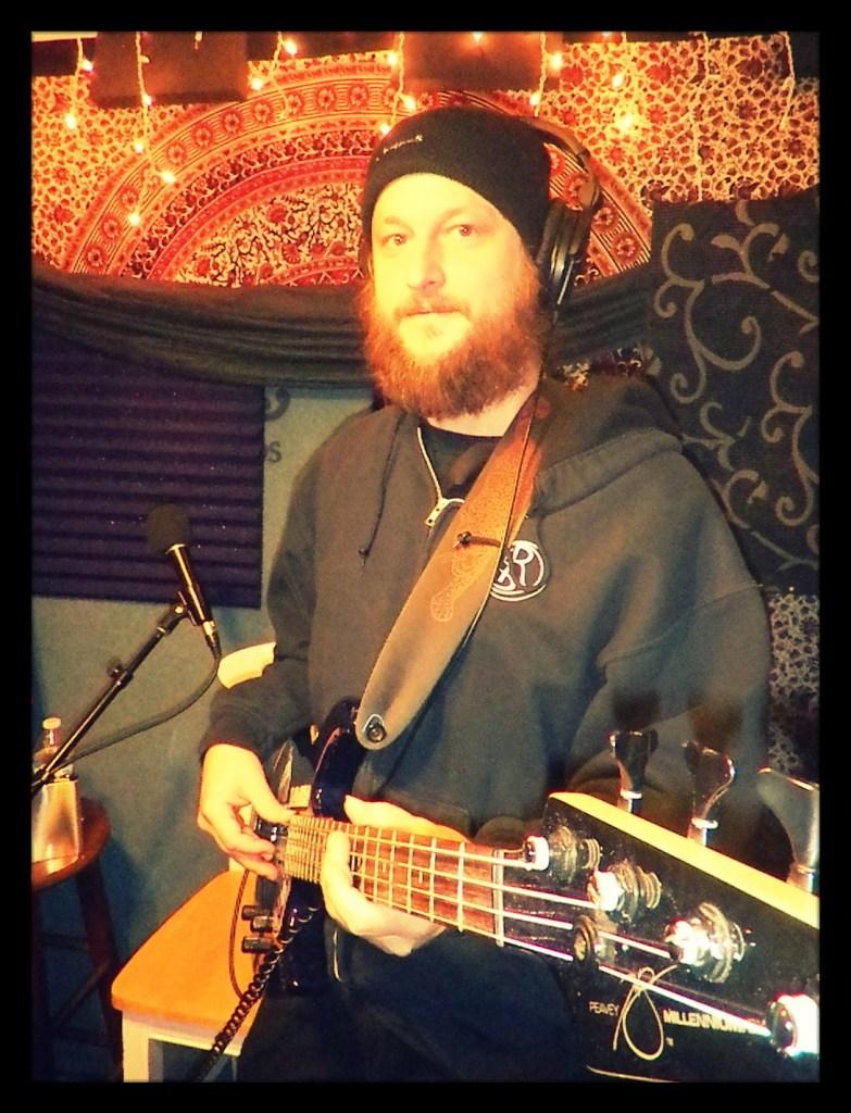 Chris from Reno metal band Kanawha posing with his guitar at Dogwater Studios,