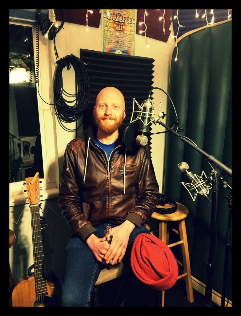 John White of Reno band the John Whites posing for the camera at Dogwater Studios while recording for the Worst Little Podcast.