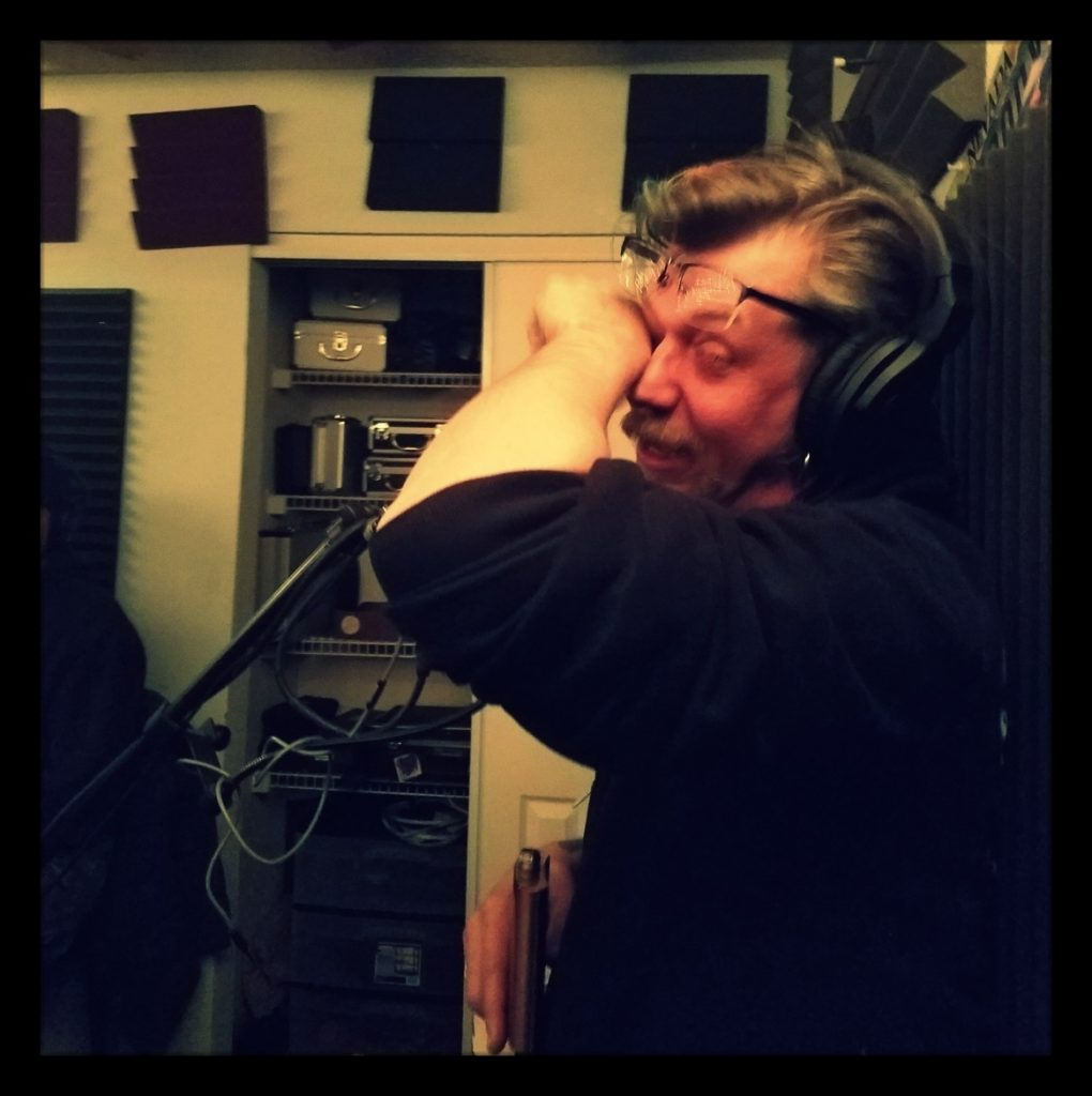 The Reverend Rory Dowd wiping tears away with his sleeve in the studio.
