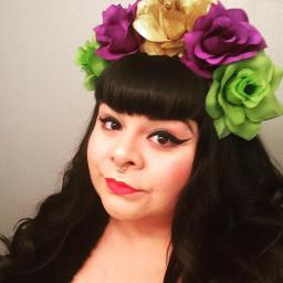 Elisa Garcia poses with a flower crown.