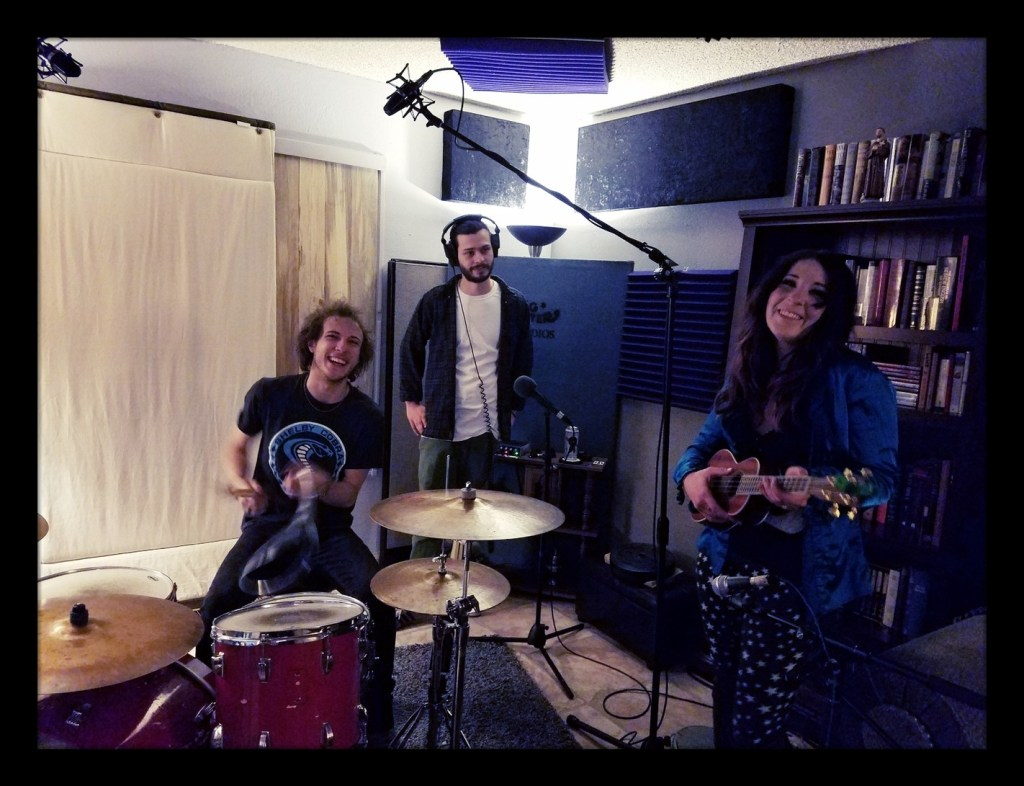 The Grimtones posing for the camera behind Carters drums at dogwater studios.