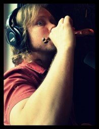 Adam Landis drinking from a flask.