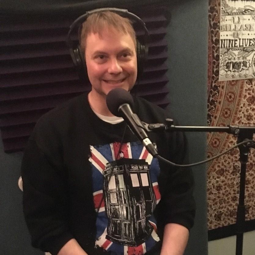 Ken McKim, smiling patiently