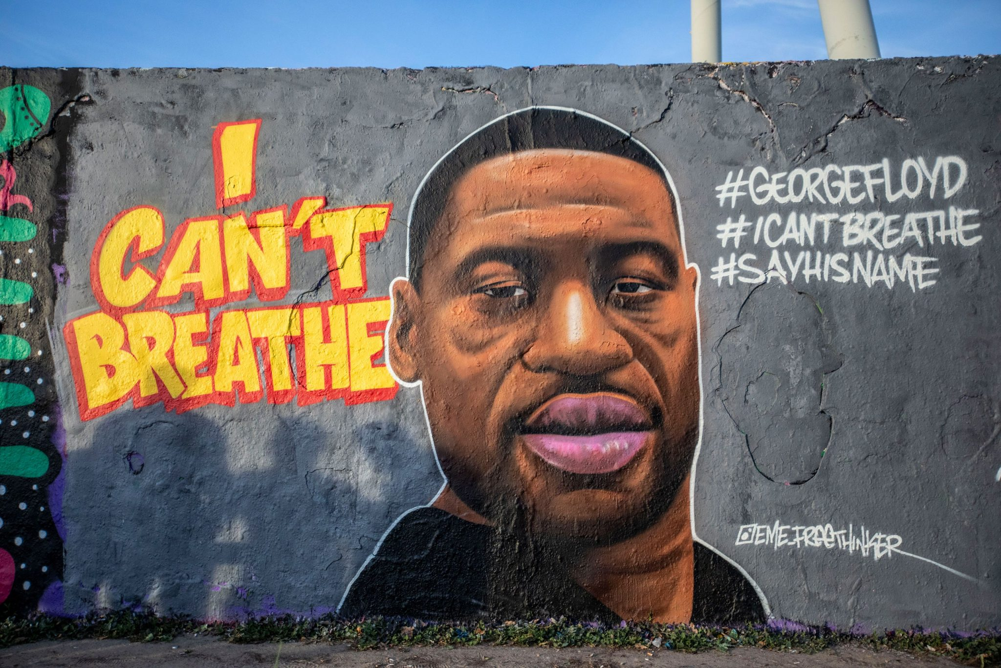 A mural of George Floyd, US citizen murdered by police on 5/25/20 #georgefloyd #sayhisname #icantbreathe wall mural of an iconic image of george floyd with accompanying text and hashtags as described