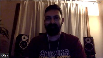 Olav Tabatabai smiling behind a thick beard