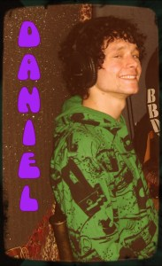 Daniel Sion smiling at the camera in a green hoodie on The Worst Little Podcast 2013 01 21