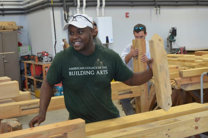 Student Jacob Jackson timber framing. Photo courtesy of American College of the Building Arts