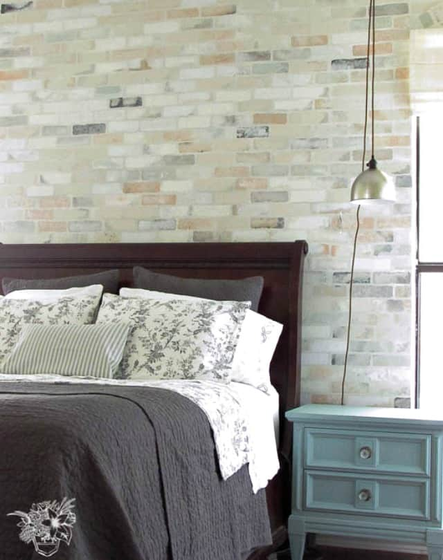 Amazingly real stenciled brick feature wall