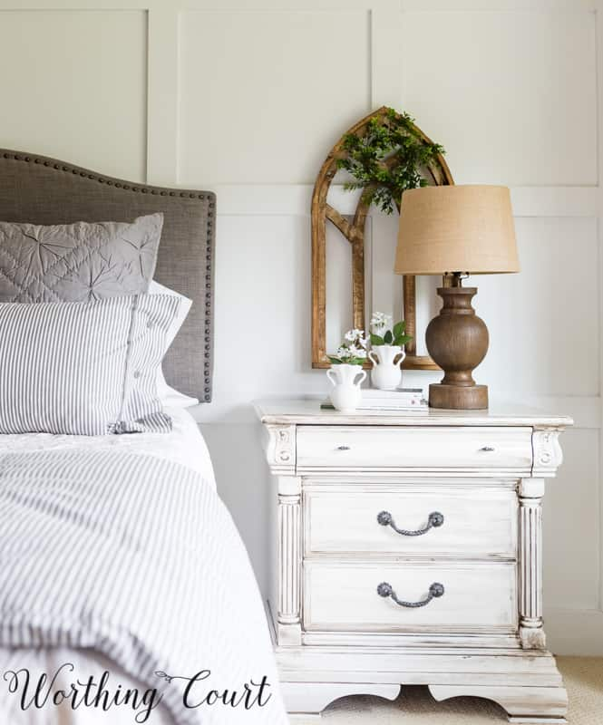 nightstand painted white beside bed