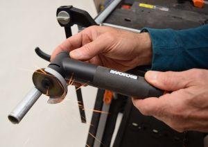 close up of hands holding black makerx angle grinder