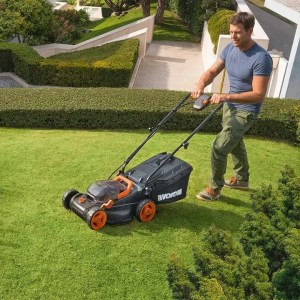 man mowing lawn with Worx WG779 cordless lawn mower