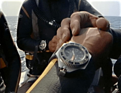 An older photograph of a Cousteau diver, with his PloProf