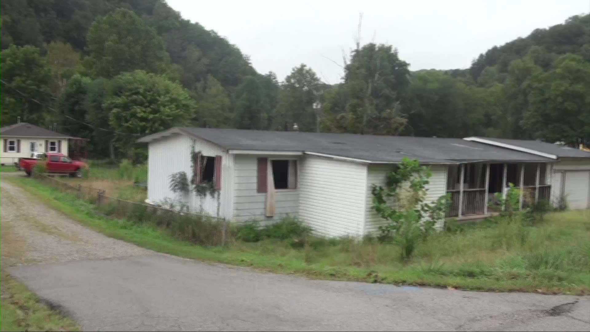 WORKING FOR YOU: Neighbors concerned about flooded, abandoned home next door