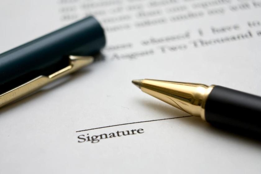contract sign stock image