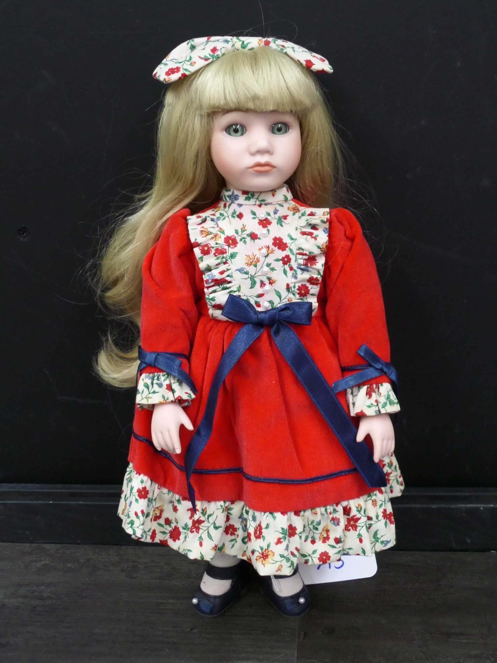 MUSICAL HOLIDAY PORCELAIN DOLL <br/> Donated by: WPBS SUPPORTER <br/> Valued at: $50 <br/> Buy It Now: $10