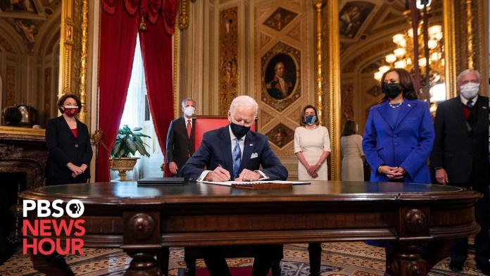 WATCH: Joe Biden signs documents at the Capitol in first presidential act after inauguration
