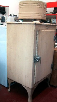 SWEHS000120b.jpg - Date c1930 - British Thomson Houston (BTH) Monitor Top also known as Beehive This is an American design with the cooling unit on top based on the General Electric Monitor Top refrigerator of 1927. It was named after the American Civil War ironclad gunship, USS Monitor. In earlier versions the sides of the cooling unit were perforated, giving rise to the nickname 'Beehive'. Worldwide sales reached around 1m and various versions were in production until 1937. It had a design life of 25 years and came in lurid colours. Later refrigerators had the compressors housed in the bottom of the cabinet and the legs disappeared. This unit was made in England by BTH. .